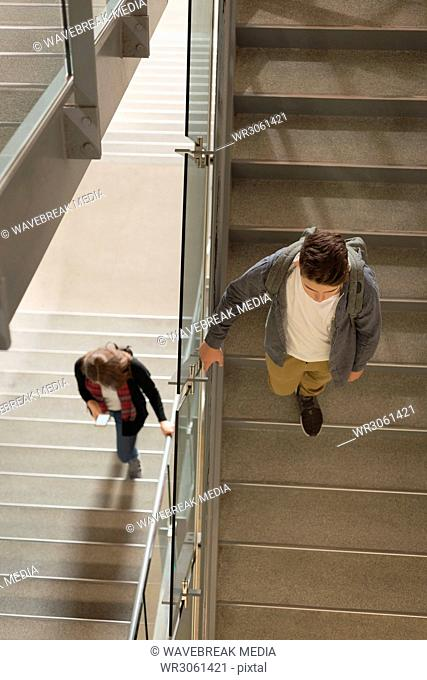 College students walking on staircase