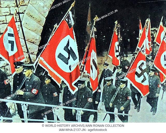 banners carried by a Nazi uniformed unit circa 1933