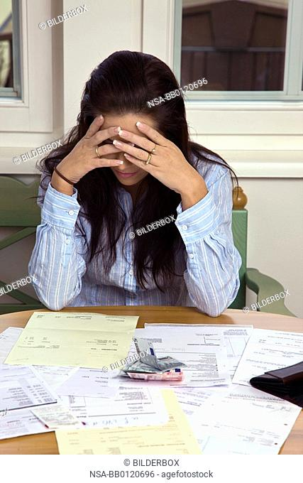 Woman with open invoices