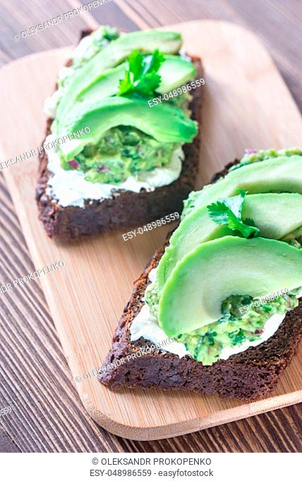 Toasts with cream cheese and guacamole