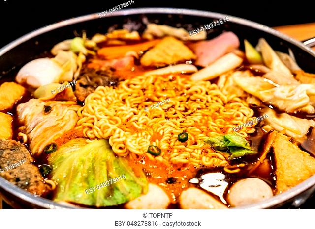 Korean Hot pot 'Budae Jjigae' is Korean fusion food incorporates American style with noodle, ham, sausages, sliced cheese and Kimchi