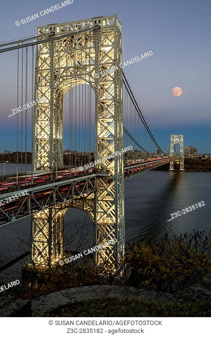 George Washington Bridge Moon Rising - New York City's landmark, the George Washington Bridge along with a full moon during the blue hour
