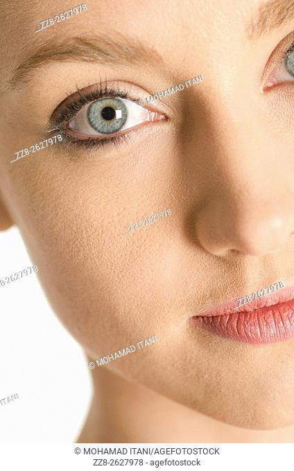 Close up of a beautiful young woman staring