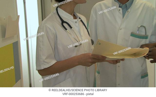 Doctors and a nurse reading a file