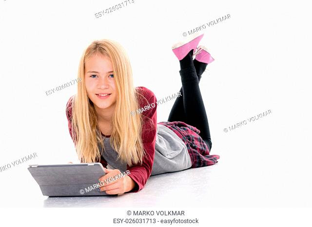 nice blond girl with tablet pc lying on the floor