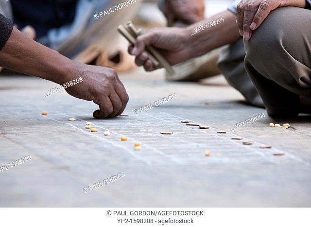 Mature men playing a game in Bhaktapur - Bhaktapur, Kathmandu Valley, Nepal