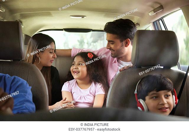 Happy family travelling in car