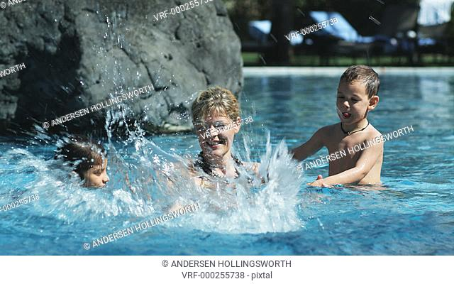 mother and children in a swimming pool