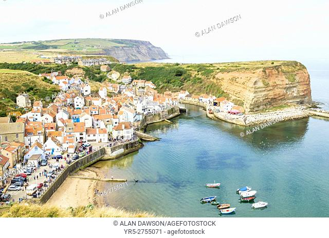 View over picturesque Staithes village looking north from Penny nab on the Cleveland Way footpath. North Yorkshire, England. United Kingdom. Europe