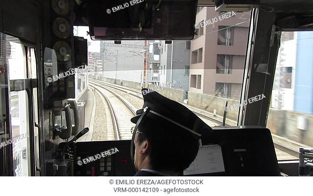Train operator driving a Keikyu train en route to Tokyo Haneda Airport, Tokyo, Tokyo Prefecture, Japan