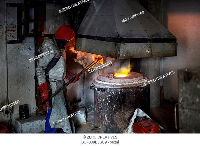 Metalworker working in foundry