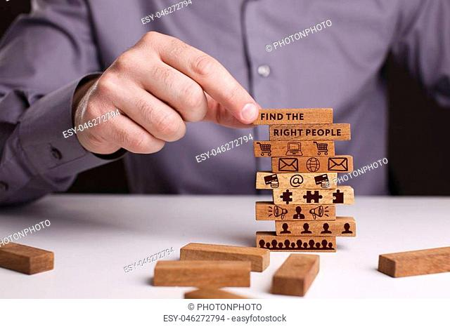 The concept of technology, the Internet and the network. Businessman shows a working model of business: Find the right people