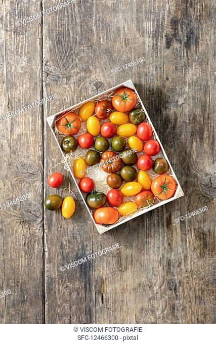 Colourful tomatoes in a crate