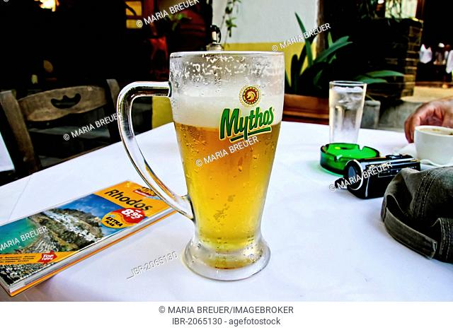 Beer glass, guidebook, tavern, historic centre of Rhodes, Greece, Europe