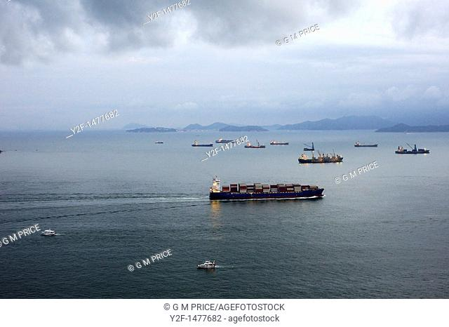 freighters and small boats near Cyberport, Hong Kong, China