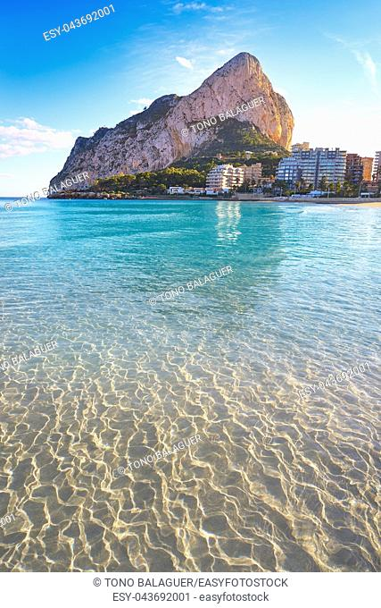 Playa de Fossa beach in Calpe and Ifach penon rock of Alicante in Spain