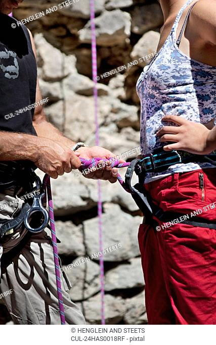 Rock climbers checking equipment