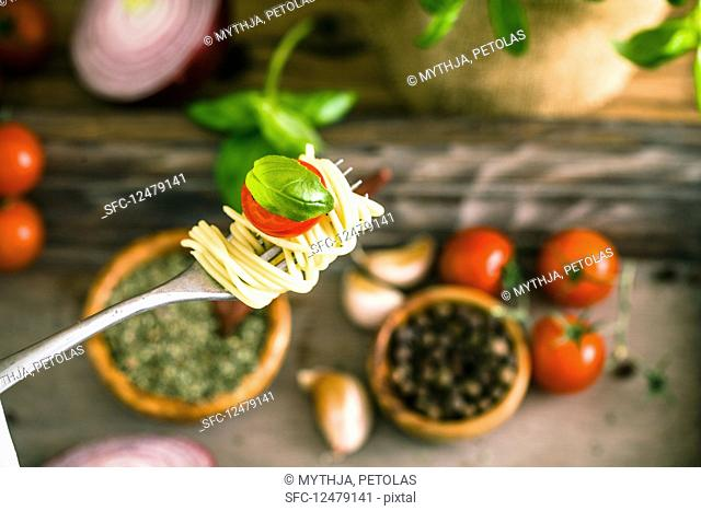 Pasta with olive oil, garlic, basil and tomatoes