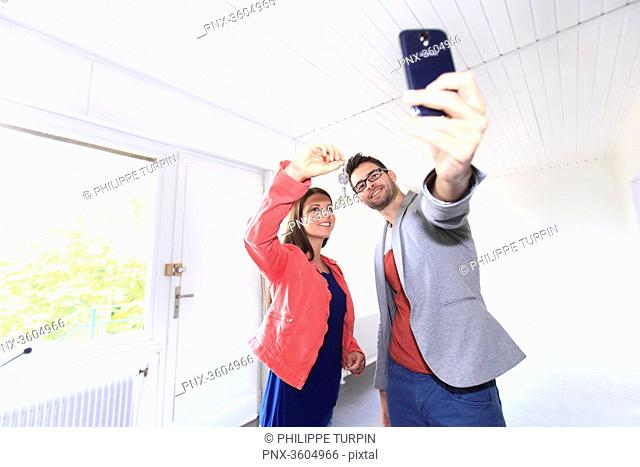 France, young person couples being caught in photograph after having to buy or rent a housing