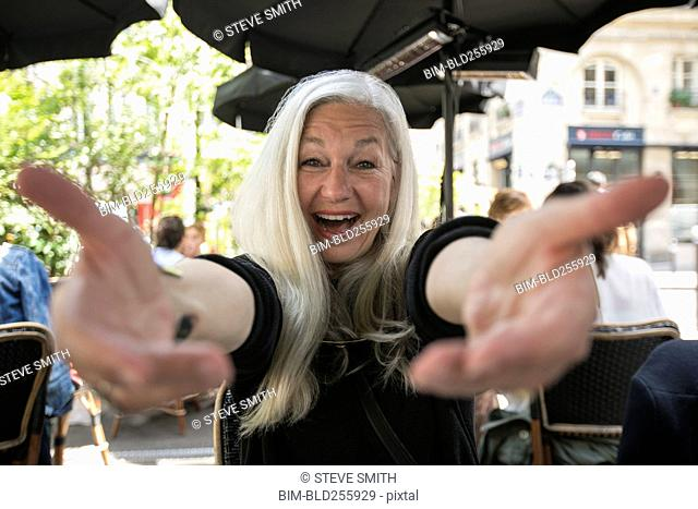 Portrait of welcoming Caucasian woman