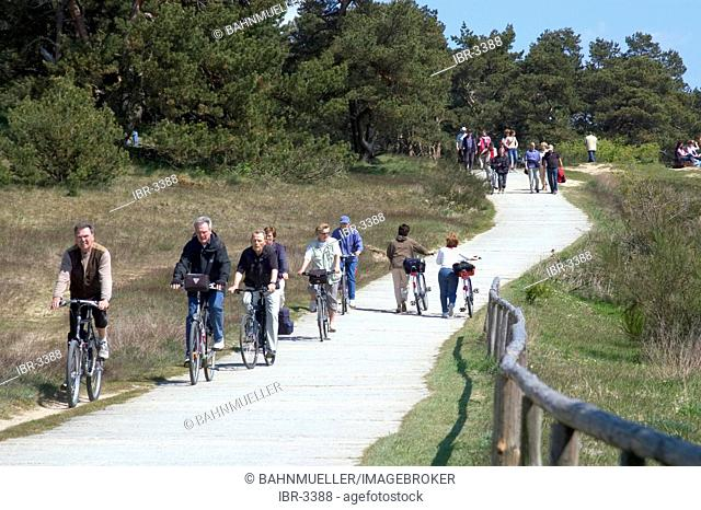 Hiddensee island Mecklenburg Vorpommern Germany path with biker and hiker to the lighthouse on the hill Schluckswiek