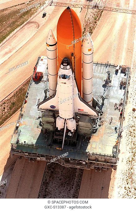 05/16/1999 -- At a juncture in the crawlerway, a crawler transporter slowly moves Space Shuttle Discovery, with its external tank and solid rocket boosters