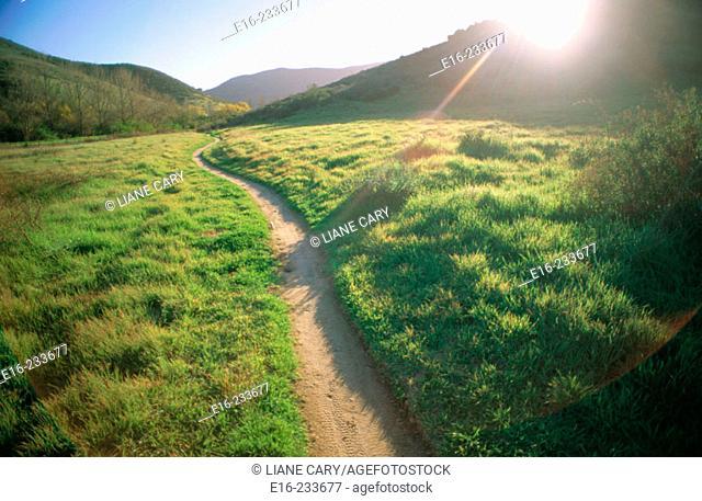 Sunset path through the hills