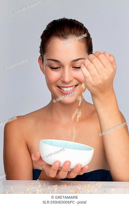 Smiling woman with bowl of grains