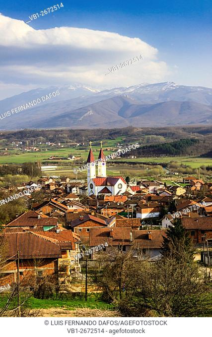 Gjakova overview and landscape with Catholic church and mountains. Gjakova, Kosovo