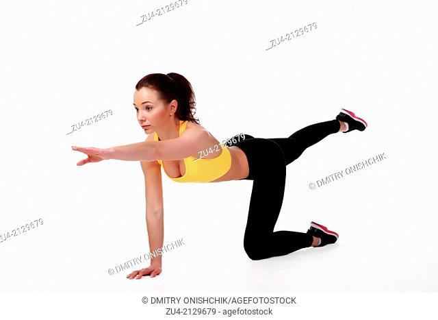 Attractive slim female model exercising