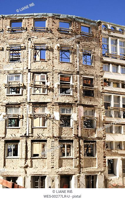 Facade of gutted building, construction work