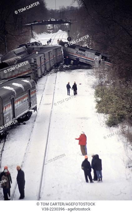 Investigators examine the scene of a fatal train crash in the cold snow in Silver Spring, Md