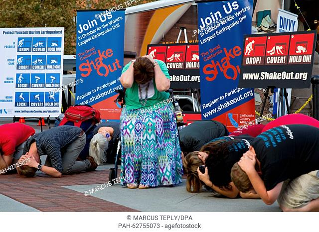 Volunteers demonstrate what to do in an earthquake during a drill in Los Angeles, California, USA, 15 October 2015. Experts predict that California will be hit...