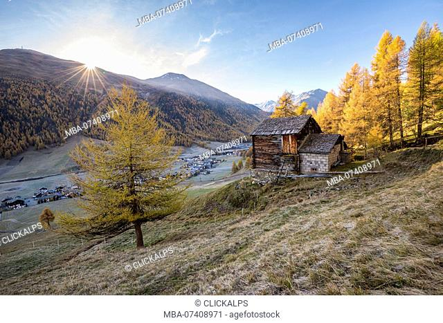 The sunrise in autumn day in Livigno, Province of Sondrio, Valtellina, Lombardy, Italy, Europe