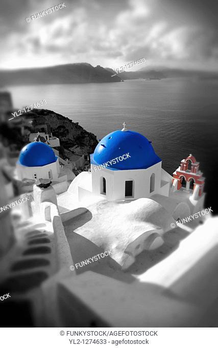 Oia, Ia Santorini - Blue domed Byzantine Orthodax churches, - Greek Cyclades islands