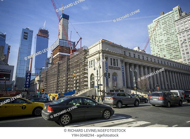 The James Farley Post Office in New York, soon to be the Moynihan Station, with the Hudson Yards development towering over it on Tuesday, February 13, 2018