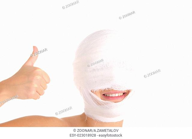 Satisfied woman with bandaged head