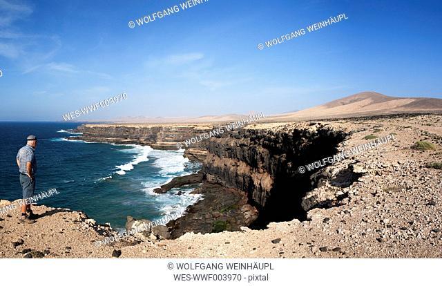 Spain, Canary Islands, Fuerteventura, West coast near Los Molinos, hiker