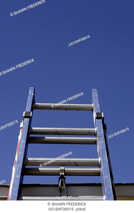 Low angle view of ladder and blue sky
