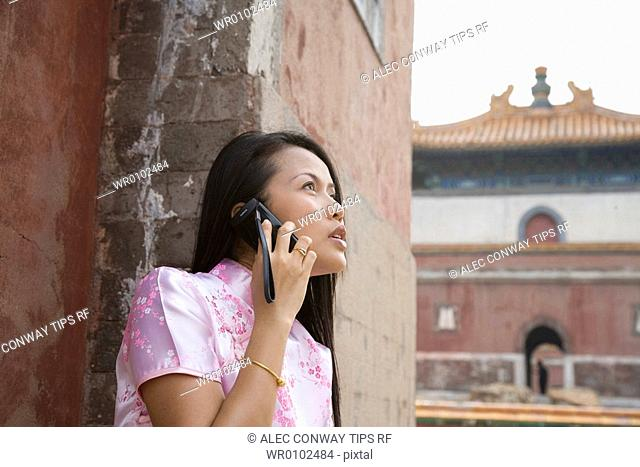 China, Beijing , the Summer Palace, asian woman on mobile