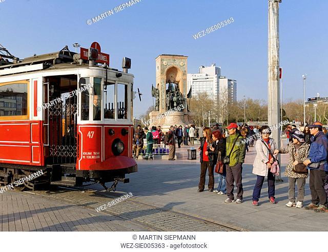 Turkey, Istanbul, Beyoglu, Taksim Meydani or square, Historical tram and Mustafa Kemal Atatuerk Memorial in the background
