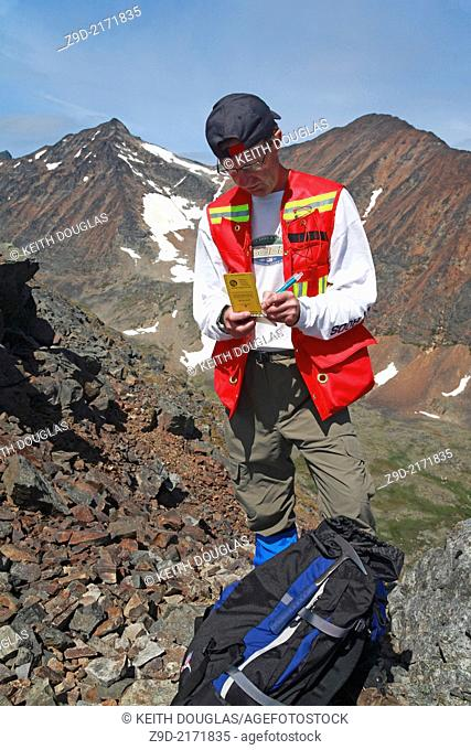 Geologist doing mining exploration fieldwork with GPS, Hudson Bay Mountain, Smithers, British Columbia