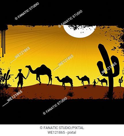 Men leading camels in a desert, Rajasthan, India