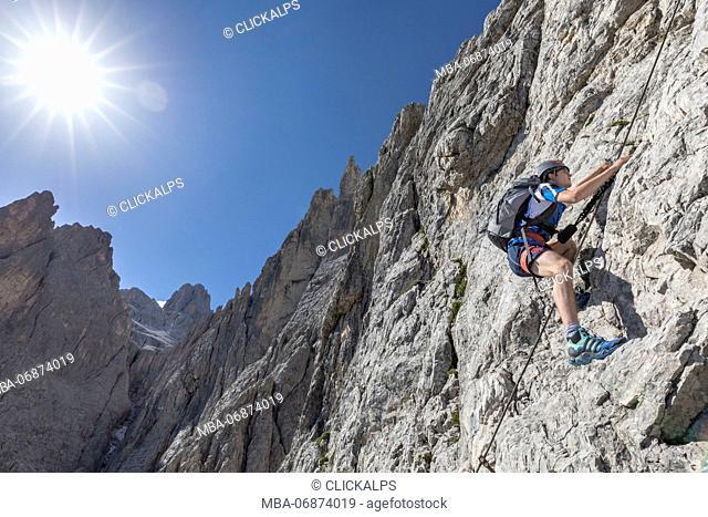 Climber on the via ferrata Roghel, Popera group, Sexten Dolomites, Comelico Superiore, Belluno, Veneto, Italy