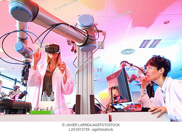 Robotic arm with artificial vision, Researcher with virtual reality glasses, VR, Humanoid robot for automotive assembly tasks in collaboration with people