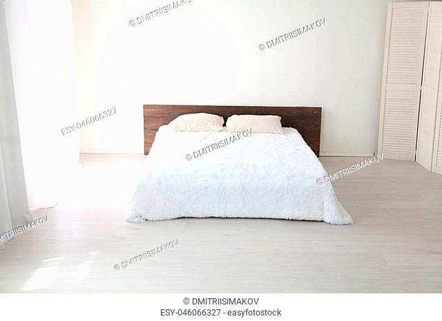 Interior white bedroom this morning with bed 1