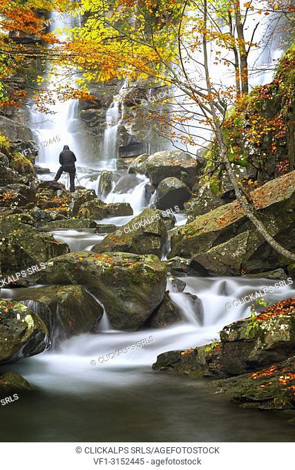 Man take a picture of Dardagna waterfalls, Corno Alle Scale Regional Park, Lizzano in Belvedere, Bologna province, Emilia Romagna, Italy, Europe
