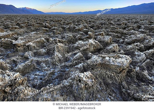 Salt crusts at the Devil's Golf Course at sunset, Panamint Range, Death Valley National Park, Mojave Desert, California, USA