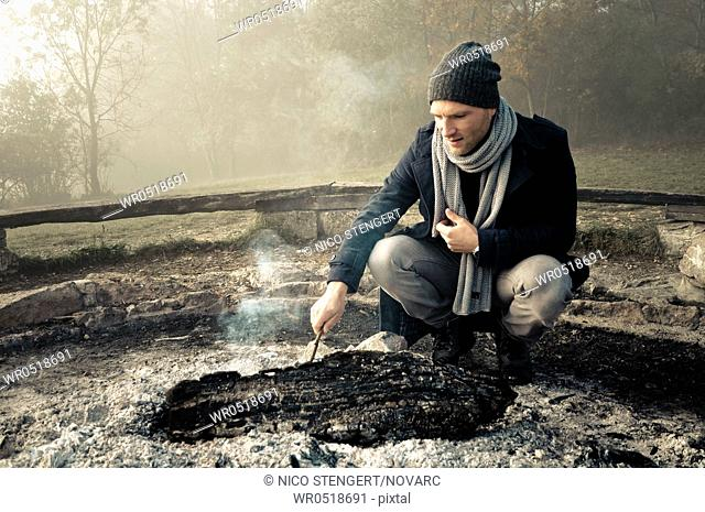Man with hat and scarf at the campfire, men's Fashion