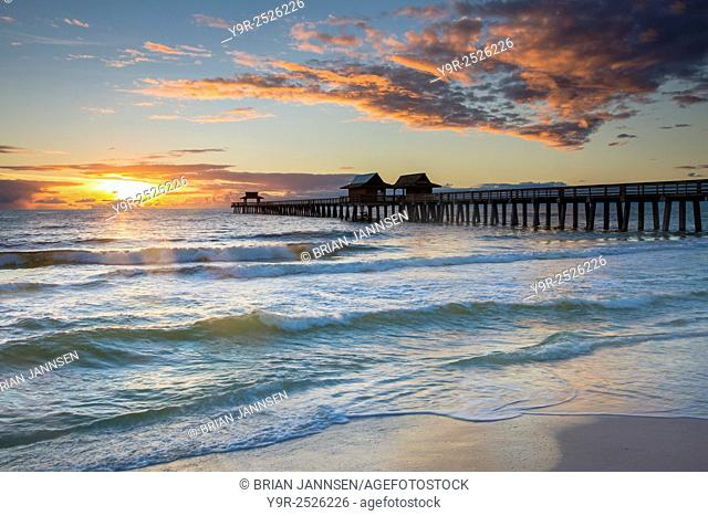 Sunset over the Naples Pier on the west coast of Florida, USA